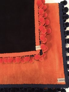 "Out of Stock - Orange velvet with navy pom poms £80 and (in stock) navy velvet with orange pom poms £65, (both 42""/1.07m square)"