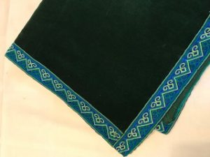 "bottle green velvet with aztec trimming (42""/1.07m sq) £65"