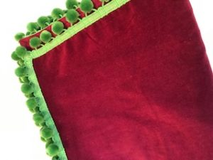 "burgundy velvet with green pom poms (42""/1.07m sq) £65"